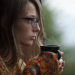 Girl Drinking Coffee Or Tea On Window
